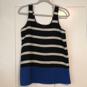 Black and white striped tank with solid blue hem